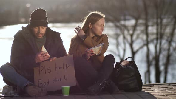 Thumbnail for Female Sharing Sandwich and Talking To Homeless