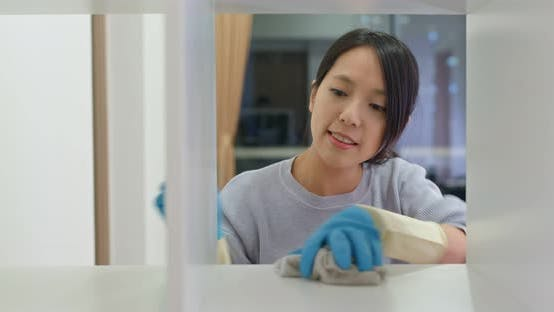Woman Clean the Cabinet at Home
