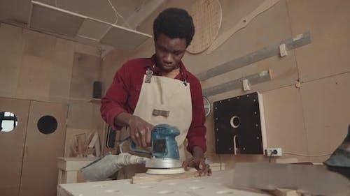 African Male Carpenter Working in Carpentry Workshop