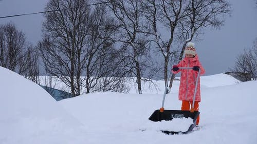 Child Girl Helping To Clean A Pathway From Snow 5