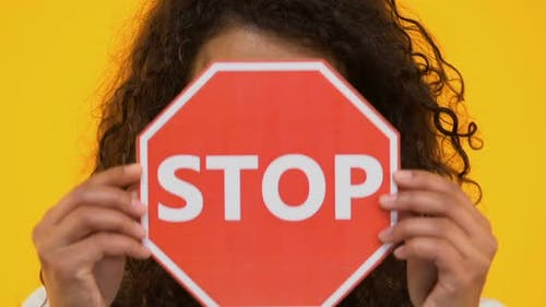 Biracial Girl Holding Stop Sign, Protesting Bullying or Racism, Gun Violence
