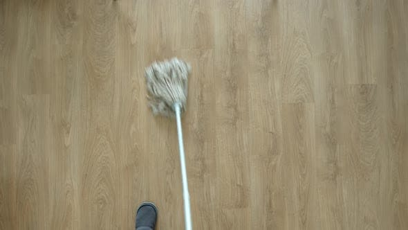 Thumbnail for Young Adult Man Washing A Floor By Mop