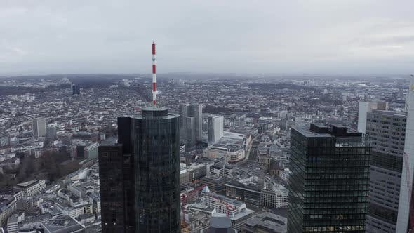 Thumbnail for AERIAL: Epic View of Frankfurt Am Main, Germany Skyline Main Tower on Cloudy Grey Winter Day