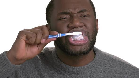Black Man Brushing Teeth