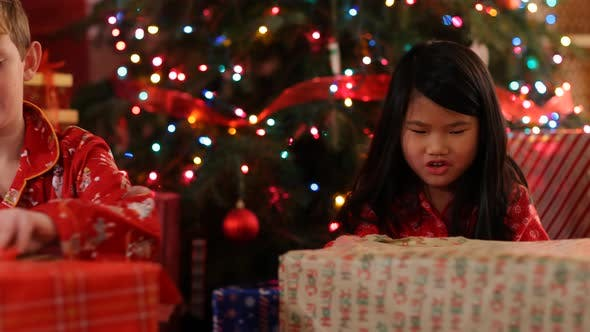 Thumbnail for Kids opening Christmas gifts