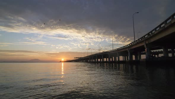 Thumbnail for Stunning sunrise with ray of Penang Bridge architecture.
