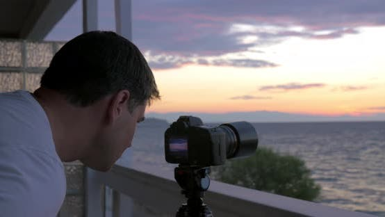 Cover Image for Man Shooting Timelapse of Sunset Over the Sea