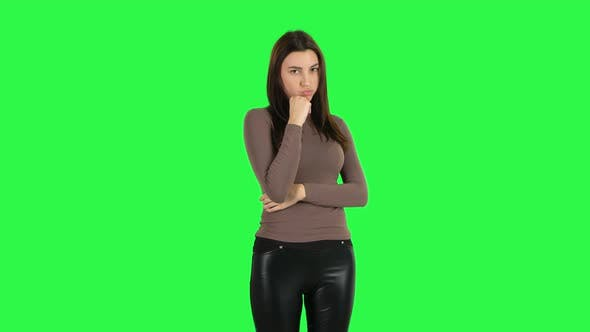 Cover Image for Attractive Girl Stands Offended and Then Smiles. Green Screen