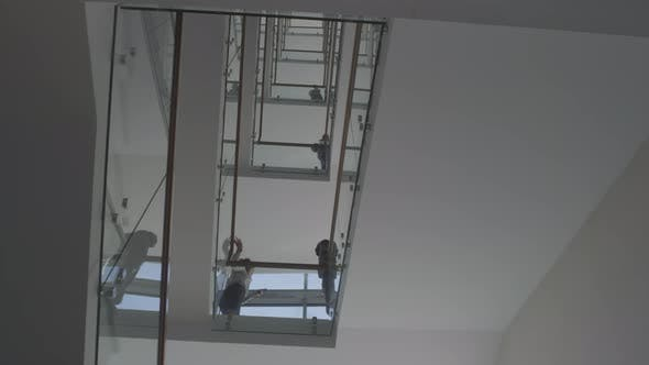 Busy Staircase in Multi-Story Office Building