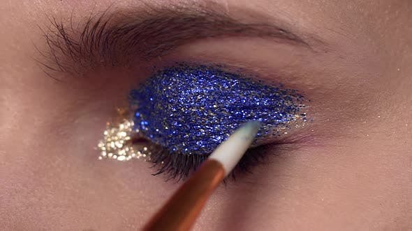 Thumbnail for Glitter Are Applied To the Woman's Eyelid, Making of the Evening Makeup, Eyes Makeup, Makeup Artist