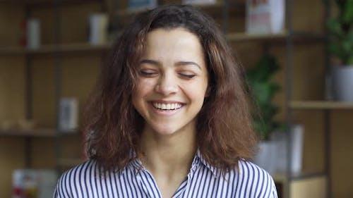 Cheerful Happy Hispanic Young Adult 20s Woman Looking at Camera Headshot