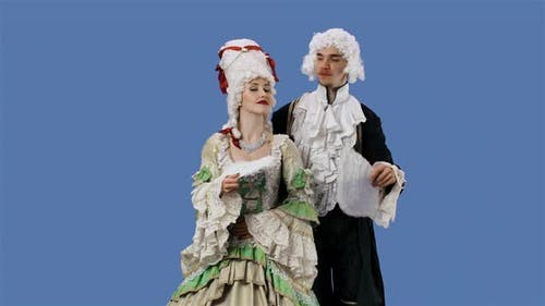 Portrait of Courtier Lady and Gentleman in Historical Vintage Costumes and Wig is Waving a Fan
