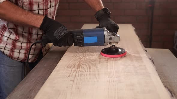 Thumbnail for Cabinet Maker Is Taking Off Upper Layer of Wood From Billet on a Factory