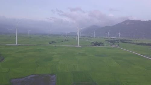 Wind turbineorwindmill in a greenfield - Energy Production with clean and Renewable Energy