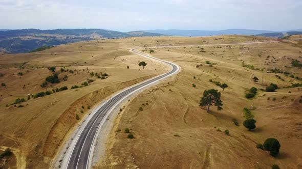 Empty Highway on the Yellow Steppe Meadow in Anatolia, Turkey