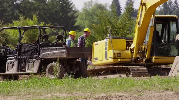 Thumbnail for Workers get out of utility vehicle and walk to jobsite