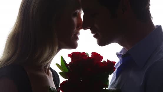 Thumbnail for Sillhoette of couple with roses