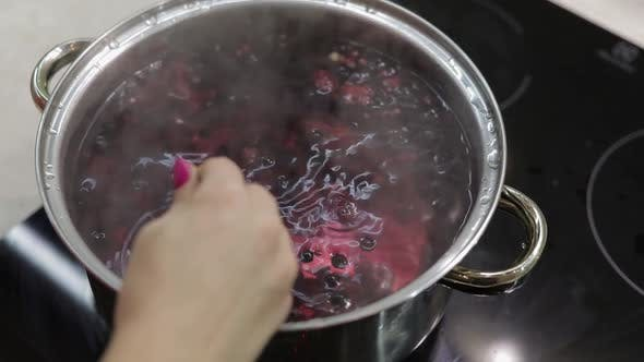 Thumbnail for Stir the Berries in Pot with Boiling Water. Cooking Compote. Kitchen