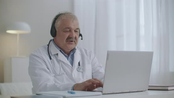Thumbnail for Head Physician of Physician Is Talking with Employees By Online Chat on Laptop During Daily Morning