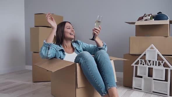 Thumbnail for Happy Caucasian Woman Sitting Inside Packing Box