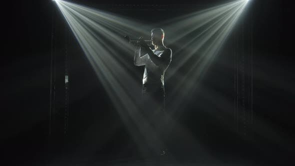 Thumbnail for A Man Plays a Wind Instrument in the Beams of Neon White Lights. Silhouette of a Male Trumpeter on a
