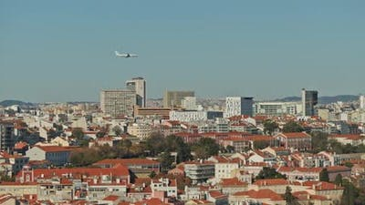 Plane is flying above the city