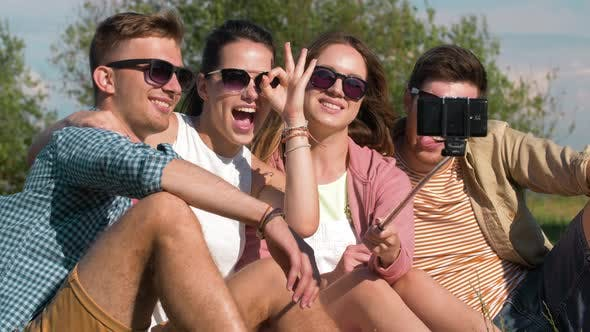 Thumbnail for Friends Taking Picture By Selfie Stick at Park