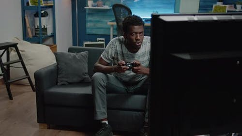 African American Man Losing at Video Games on Console