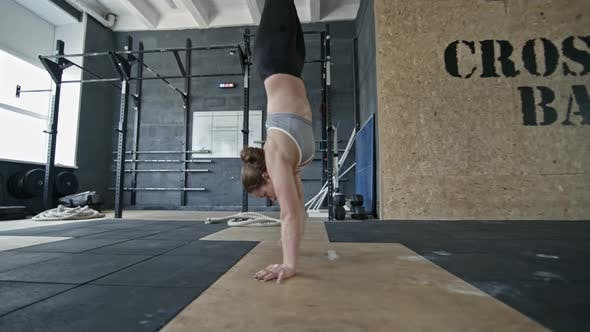 Thumbnail for Athletic Woman Walking on Hands in Gym