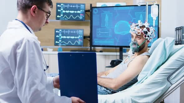 Patient in a Neuroscience Centre Wearing Brainwaves Scanning Headset and Air Mask