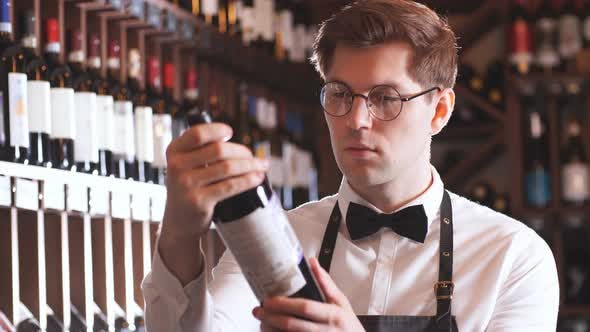 Thumbnail for Sommelier Presenting Bottle of Red Wine To Customer in a Wine Store