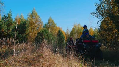 Family Rides Quad Bikes in the Woods