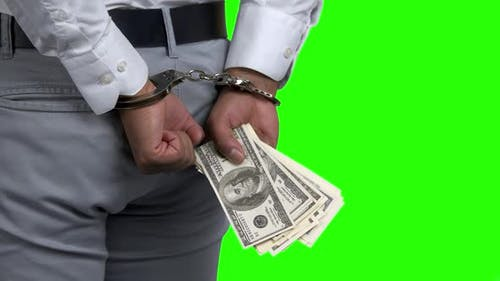 Man in Handcuffs Holding Money Back View