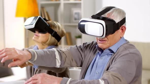 Thumbnail for Two Seniors Enjoying VR Glasses