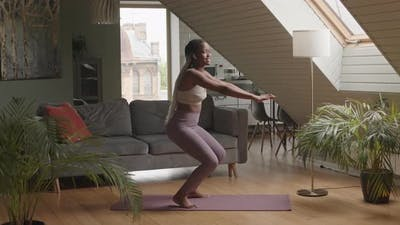 African American Woman Working out at Home