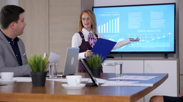 Thumbnail for In Conference Room Businesswoman with a Clipboard in Hands Presents Company Data