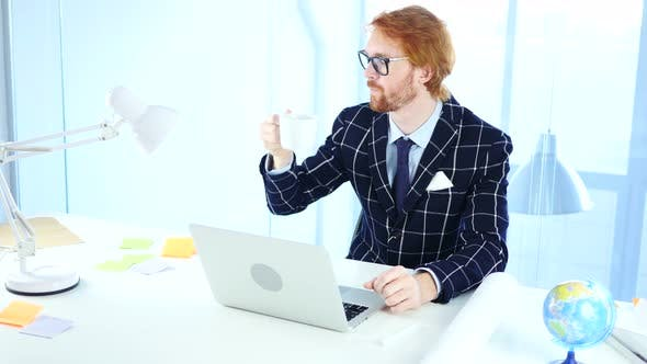 Thumbnail for Redhead Businessman Drinking Coffee at Work, Relaxing Freelancer Designer