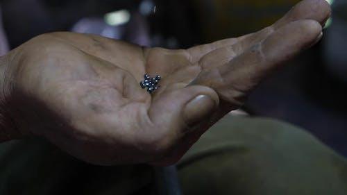 Bullets Gun On The Elderly's Hand