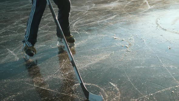 Thumbnail for Ice Hockey Player Point of View Shot of a Puck Being Shot on Frozen Lake, Professional Player