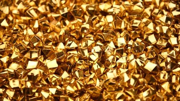 Abstrakter Hintergrund der goldenen Nuggets drehen