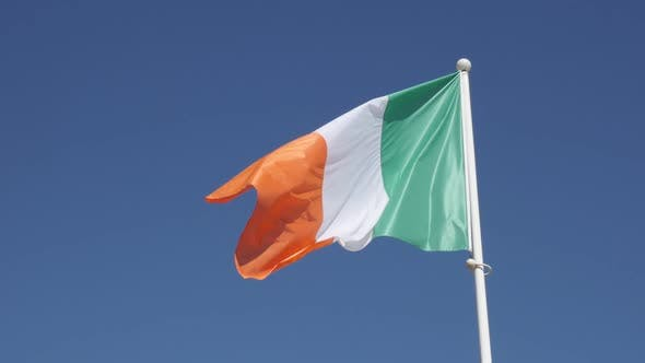 Thumbnail for Slow motion Irish flag waving against blue sky1920X1080 HD footage - Famous tricolor state symbol fa