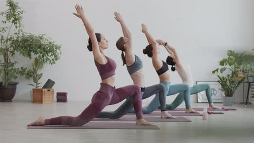 Four Female Yogi Having Yoga Practice