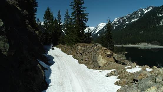 Snowmobiling Fast Speed Trail Riding Through Rocky Terrain Winter Motorsport Hardcore Extreme Sport