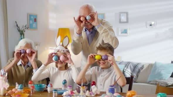 Cover Image for Family Holding Easter Eggs over Eyes