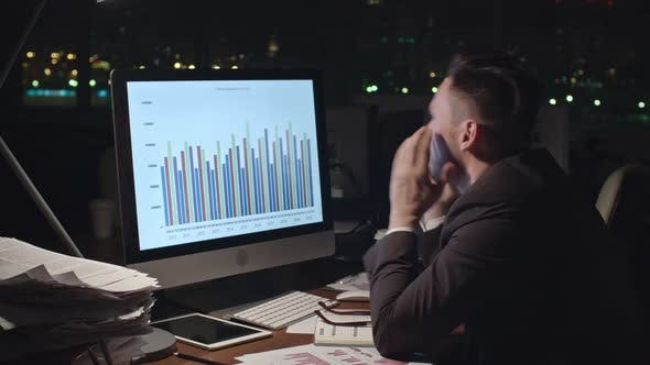 Thumbnail for Tired Businessman Analyzing Financial Data