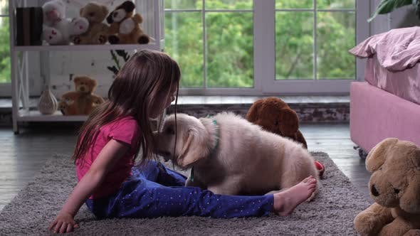 Thumbnail for Little Child Having Fun with Puppy Pet on Carpet