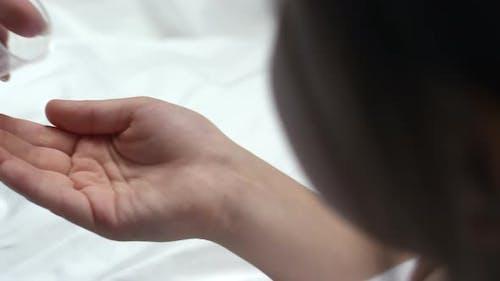 Female Patient Taking Pills