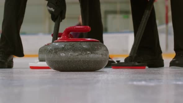 Cover Image for Curling Training - a Granite Stone Biter with Red Handle Hitting Another Biter of Opposite Team