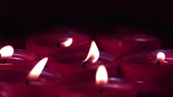Thumbnail for Pink candles flickering in the breeze