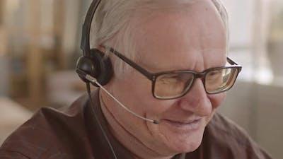 Close-Up of Senior Call Center Worker